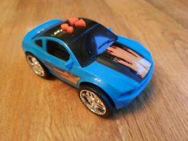 Elc car that plays music and lights up