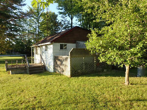 House / building lot for sale 45 minutes north of Toronto.