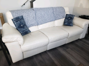 Natuzzi leather couch with power recliners!