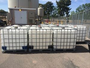 1000 lt water totes skid bottoms London Ontario image 8