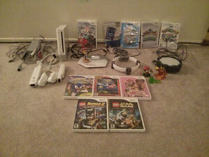 Nintendo WII  WITH LOTS OF GAMES AND accessories