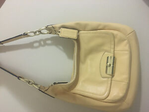 Coach leather bag preowned in yellow
