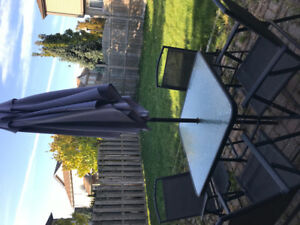 Patio table, 4 chairs and umbrella.  Must be sold.