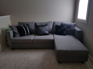Almost new grey reversible chaise sectional