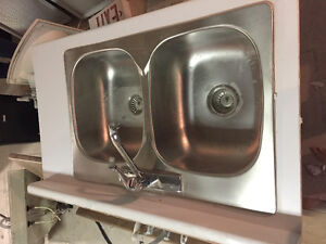 Counter top with double sink and taps.
