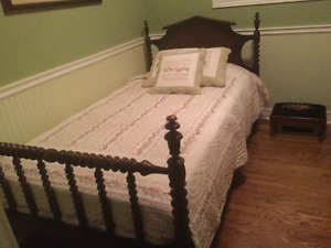 Single antique walnut bed and new mattress