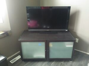 Dark Ikea TV stand. Frosted glass.