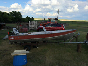 (SOLD)  Aluminum 14ft Lund Boat , with 9.9 hp Johnson motor .