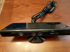 Xbox 360 Kinect with optional power adapter.