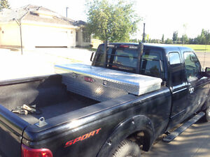 Selling an Aluminum ToolBox and a BackRack for compact Truck.