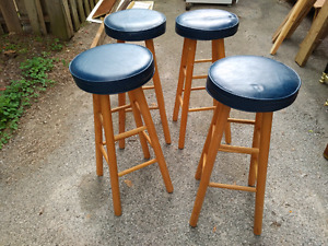 Four slightly used bar stools