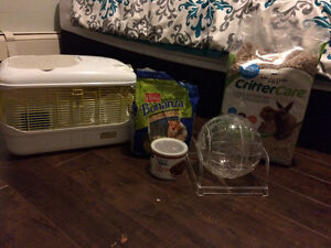 Hampster plus 2 cages ,and all the extras