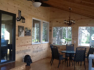 Stylish Candle Lake Cabin wVaulted Screen Room - Only $209,900