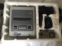 Boxed Super Nintendo with controller and wires
