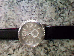 Stainless steel Fossil watch with black leather band
