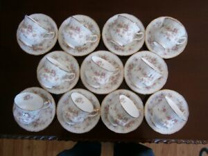ELEVEN PARAGON VICTORIANA ROSE CUP AND SAUCER SETS