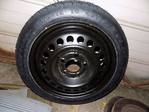 Compact Spare never used 5 x 115 bolt pattern GM Kitchener / Waterloo Kitchener Area image 1