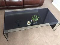 Beautiful black rolled glass coffee and side tables