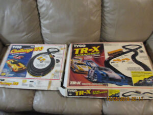 TYCO SLOT CAR SET,2 SETS OF TRACK AND TRANSFORMERS,1982,1985
