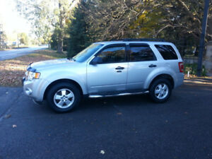2009 Ford Escape, Saftied, Etested & Warrantied.  Only 143K