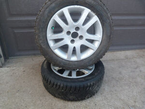 2 195/60R15 NOKIAN Winter tire on alloy rims.