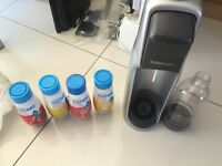 Sodastream in grey And black with the gas and some opened flavours