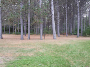 Amazing 2.2 ac lot on a quiet lane, partial view of Round Lake