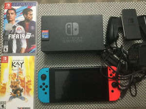 Nintendo Switch with accessories and 3 games Mario + Rabbids