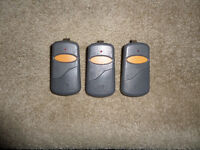 STINGER REMOTE GARAGE DOOR OPENERS 390MHZ (THREE)REDUCED PRICE