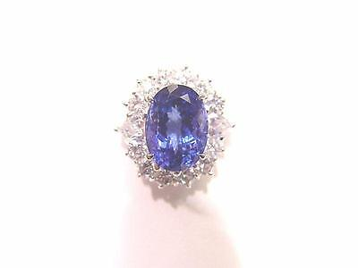 3.78 CT TANZANITE OVAL OVAL CUT SET WITH 12 ROUND BRILLIANT CUT DIAMONDS 18 K