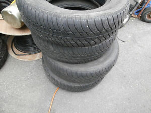 1 set all season motomaster tires in good shape 185/70/14 left