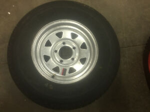 "New 13"" galvanized wheel and new trailer tire for sale"