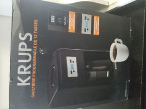Krups Coffee maker $40,  convertible rail and bed rail $25,