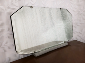 Art deco vintage mirror with scalloped bevelled edging. Crown clasps.