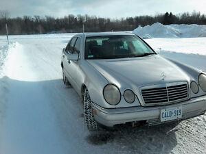 1998 Mercedes-Benz 300-Series E320 Sedan 4Matic all wheel drive.