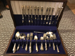 Morning Star silver plate flatware set in chest. (65pieces)