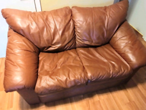 Leather loveseat - text 416-400-6479