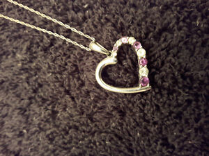 White gold heart necklace with amethysts and diamonds