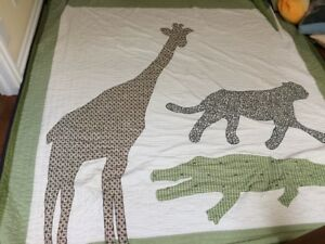 Child Pottery Barn animal quilt, shams, and accent pillows!!