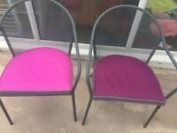 Two metal garden chairs with cushions