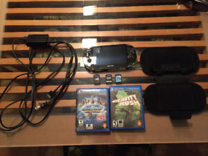 PS Vita with 3 games, charger and soft carrying case