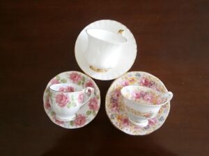 THREE COLLECTABLE DEMI-TASSE CUP & SAUCER SETS