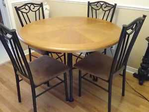 Round wood and wrought iron table and 4 cushioned chairs