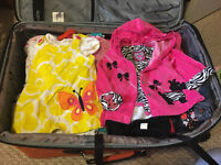 A suitcase full of baby girl clothing