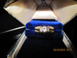 14 KT Diamond Solitaire surrounded with 2 Marquise total wt .47