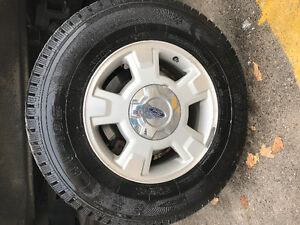 4 Ford F-150 rims and 4 winter tires $550