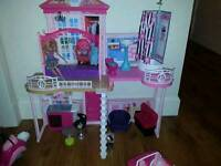 Large barbie bundle. beach house, car, scooter, furniture, 10+ dolls with acessories