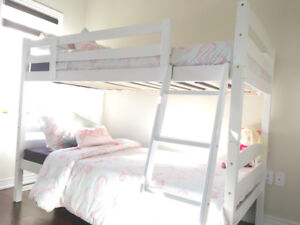 White bunk bed including mattresses and comferter sets