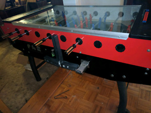 Coin operated Foosball table / table de babyfoot