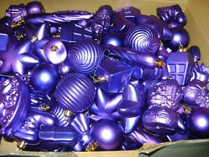 LARGE BOX OF PLASIC PURPLE TREE ORNAMENTS